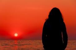 Sunrise. Female at sunrise Royalty Free Stock Images