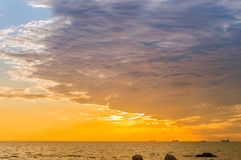Sunrise. Seaside sunrise, blue sky and white clouds sea and golden sunlight Royalty Free Stock Photography