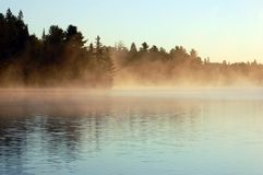 Sunrise. And mist in beautiful lake in Algonquin Park Royalty Free Stock Photography