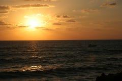 Sunrise. Photo with fishing boat Royalty Free Stock Photos