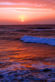 Sunrise. Beautiful sunrise at early morning on indian ocean with red lights reflect on the sea surface, picture taken on Umhlanga beach, Durban, South Africa Stock Photos