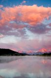 Sunrise. The reflection on clouds on a river at grand tetons Stock Image