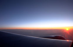 Sunrise. At an altitude of ten thousand meters Royalty Free Stock Photo