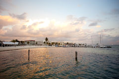 Sunrise. In a Cancun beach. Hotels and boats in the back Royalty Free Stock Photos
