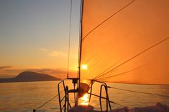 Sunrise aboard a sailing yacht Stock Photo