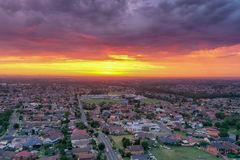 Free Sunrise Above A Residential Suburbs With Streets, Homes Parks In The Background. Dramatic Lighting And Warm Colours Royalty Free Stock Photography - 138789517