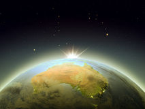 Sunrise above Australia from space Stock Photo