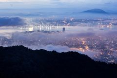 Sunrise above the cloud view of George Town City from Penang Hill. Beautiful landscape series of sunrise and sunset collection from George Town, Penang, Malaysia Royalty Free Stock Images