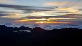 Sunrise above the clouds royalty free stock photo