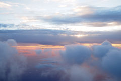 Sunrise above clouds during a flight Stock Photography