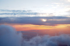 Sunrise above clouds during a flight Royalty Free Stock Photos