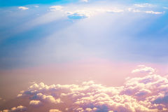 Sunrise above clouds Stock Photo