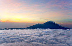 Sunrise above clouds with a mountain volcano view Royalty Free Stock Photography