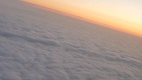 Sunrise above the clouds stock video