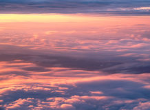 Sunrise above the clouds. Sky and clouds image taken form above while flying in a plane Stock Photo
