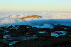 Sunrise above the clouds which illuminates the top of a mountain in Tenerife Island. Canary. Span, Europe Royalty Free Stock Photos