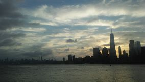 Sunrise above Downtown Manhattan in New NY across Hudon River - View from Liberty State Park in Jersey City, NJ. Sunrise above Downtown Manhattan with Freedom Royalty Free Stock Photography