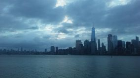 Sunrise above Downtown Manhattan in New NY across Hudon River - View from Liberty State Park in Jersey City, NJ. Sunrise above Downtown Manhattan with Freedom Royalty Free Stock Images