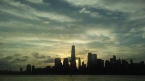 Sunrise above Downtown Manhattan in New NY across Hudon River - View from Liberty State Park in Jersey City, NJ. Sunrise above Downtown Manhattan with Freedom Stock Photography