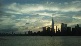 Sunrise above Downtown Manhattan in New NY across Hudon River - View from Liberty State Park in Jersey City, NJ. Sunrise above Downtown Manhattan with Freedom Stock Photo