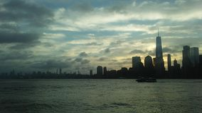 Sunrise above Downtown Manhattan in New NY across Hudon River - View from Liberty State Park in Jersey City, NJ. Sunrise above Downtown Manhattan with Freedom Stock Image