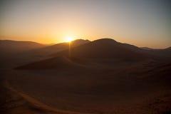 Sunrise above dunes in Namib Desert, Namibia Stock Images