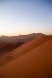 Sunrise above dunes in Namib Desert, Namibia Royalty Free Stock Images