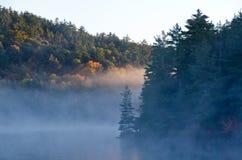 Sunrise above forest lake Stock Photography