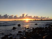 Sunrise above Hilo Bay in Hilo, Hawaii. Royalty Free Stock Photography