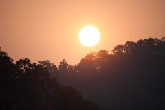 Sunrise above Indian jungle stock image