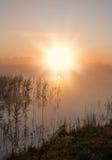 Sunrise above lake Stock Image