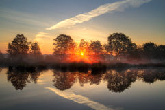 Sunrise above a lake Royalty Free Stock Image