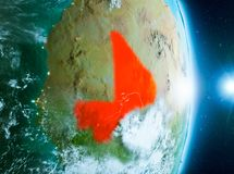 Sunrise above Mali on planet Earth. Mali from orbit of planet Earth with clouds during sunrise with highly detailed surface textures. 3D illustration. Elements Stock Photo