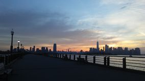 Sunrise above Manhattan, New York, NY Seen from Liberty State Park in Jersey City, NJ. Sunrise above Manhattan, New York, New York Seen from Liberty State Park Royalty Free Stock Image