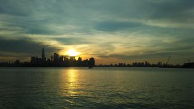 Sunrise above Manhattan, New York, NY Seen from Liberty State Park in Jersey City, NJ. Stock Photo