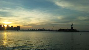 Sunrise above Manhattan, New York, NY Seen from Liberty State Park in Jersey City, NJ. Royalty Free Stock Photo