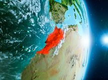 Sunrise above Morocco on planet Earth. Morocco from orbit of planet Earth with clouds during sunrise with highly detailed surface textures. 3D illustration royalty free stock images