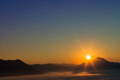 Sunrise above the mountain and sea of mist Stock Images