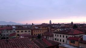 Sunrise Above Pisa. Videoclip of sunrise above the roofs of Pisa in Tuscany, Italy stock footage