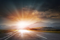 Sunrise above road Stock Images