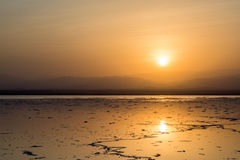 Sunrise above a salt lake in Ethiopia Royalty Free Stock Photo