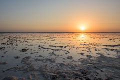 Sunrise above a salt lake in Ethiopia Stock Photo