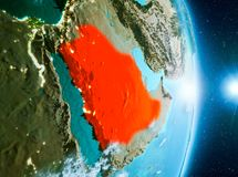 Sunrise above Saudi Arabia on planet Earth. Saudi Arabia from orbit of planet Earth with clouds during sunrise with highly detailed surface textures. 3D Royalty Free Stock Image