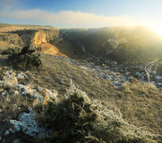 Sunrise above the snow-covered rocks Stock Images
