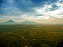 Sunrise above volcano on Kamchatka in cloudy day royalty free stock photos