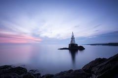 Before sunrise. Achtopol`s lighthouse before sunrise Bulgaria, Black sea Stock Photos