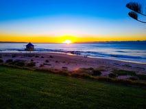 Sunrise across the ocean stock images