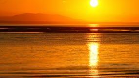 Sunrise Across Sea Stock Photos