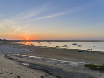 Sunrise aerial seascape, in Ria Formosa wetlands natural park, shot over Cavacos beach. Algarve. Portugal royalty free stock photo