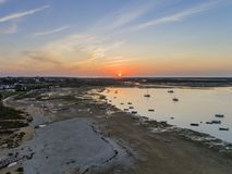 Sunrise aerial seascape, in Ria Formosa wetlands natural park, shot over Cavacos beach. Algarve. Portugal royalty free stock photos